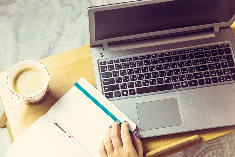 laptop on a lap desk or tray